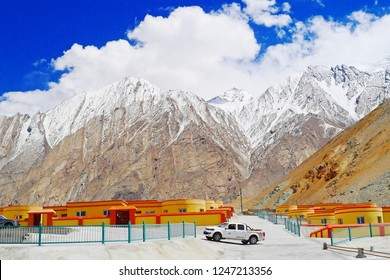 KASHGAR, CHINA - MAY 7, 2018: A new village of minority group of people in China on the Karakoram Highway rest area with snow mountain background, ancient silk road from Kashgar to Pakistan, Xinjiang.