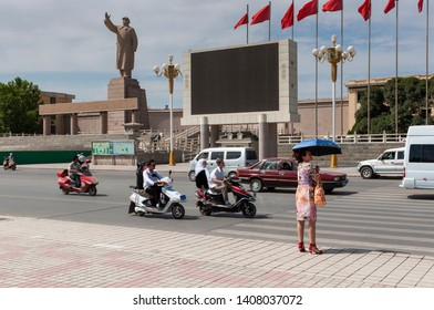Kashgar, Xinjiang, China - August 14, 2012: View of an avenue in the city of Kashgar with a statue of Mao Zedung, Xinjiang, China