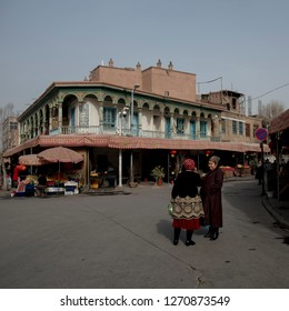Kashgar, Xinjiang, China, December 30 2018- two elderly woman chatting in front of street of old city of Kashgar. Old city of Kashgar is one of the oldest city and has majority of muslim uyghur people