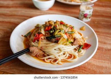 KASHGAR, XINJIANG / CHINA - October 1, 2017: Traditional Laghman, served in a restaurant in Kashgar. Laghman are pulled noodles, prepared with meat (usually lamb) and vegetables.
