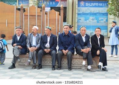 Kashgar, Xinjiang, China - October 19 2018: Local people  in Kashgar at the main road waiting to see