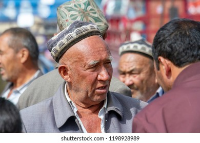 Kashgar, Xinjiang, China - September 15, 2018 :  Portrait of Uyghur man during Sunday Livestock Bazaar in Kashgar, or Kashi, Xinjiang, China.
