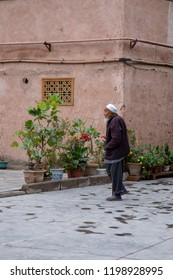 Kashgar, Xinjiang, China - September 15, 2018 :  Senior Uigher man in traditional attire on streets of Old City in Kashgar, or Kashi, Xinjiang, China.