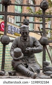 Kashgar, Xinjiang, China - September 15, 2018 :  Statue of traditional Uigher hat maker in Old City  Kashgar, or Kashi, Xinjiang, China.