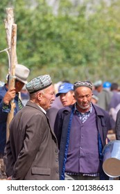 Kashgar, Xinjiang, China - September 16, 2018 :    Senior Uyghur men at the Sunday Livestock Bazaar and Market in Kashgar, or Kashi, China.