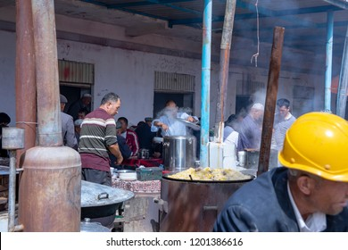 Kashgar, Xinjiang, China - September 16, 2018 :   Vendors selling prepared food at the Sunday Livestock Bazaar and Market in Kashgar, or Kashi, China.