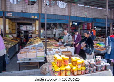 Kashgar, Xinjiang, China - September 16, 2018 :   Shoppers buying bulk foods at the Sunday Bazaar in Kashgar, or Kashi, China.