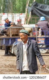 Kashgar, Xinjiang, China - September 16, 2018 :    Senior Uyghur man at the Sunday Livestock Bazaar and Market in Kashgar, or Kashi, China.