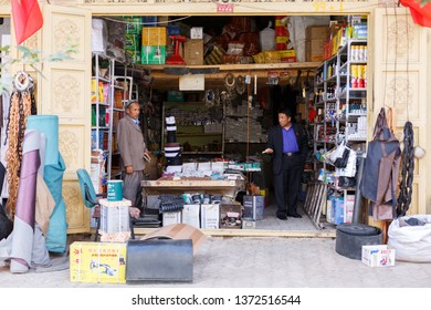 KASHGAR, XINJIANG / CHINA - September 30, 2017: A view into a store in Kashgar Old Town: The customer on the right is asking the shopkeeper for advice.