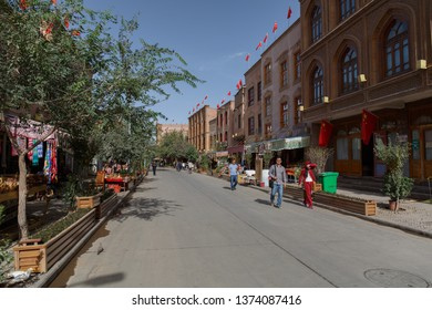 KASHGAR, XINJIANG / CHINA - September 30, 2017: View of a street in Kashgar Old Town. Chinese flags on top of the buildings indicate the time when the photo was taken: Chinese National Holiday.