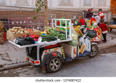 KASHGAR, XINJIANG / CHINA - September 30, 2017: Trike at a bazaar in Kashgar Old Town. A selection of vegetables is on display for sale.