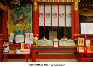 Kashima ,Saga ,Kyushu ,Japan - May 6th,2015 : Shinto shrine maiden call in Japanese is Miko in the Omamori shop that is sold Japanese amulets for luck inside Yutoku Inari Shrine (Yutoku Inari Jinja).