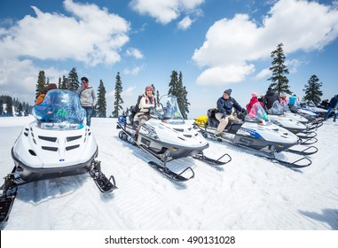 Kashmir, India on April 14, 2015 : A group of snow bike travelling accross on snow covered field in Gulmarg, Kashmir