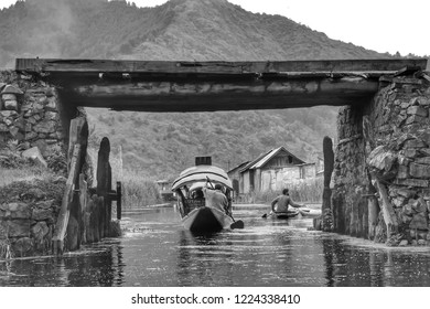 Kashmir people use boats make a journey in Dal lake,Srinagar,India.black and white picture