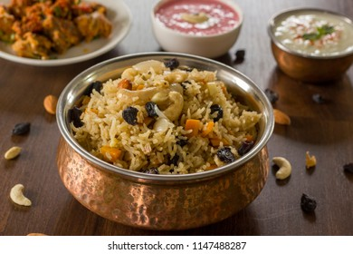 Kashmiri pulaois an aromatic, mild and sweet. Rice is cooked with milk and loaded of dry fruits and fresh fruits.