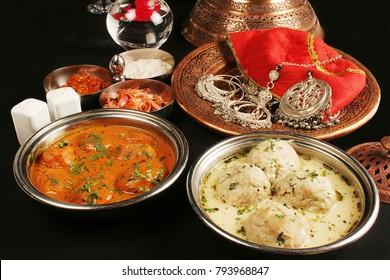 Kashmiri Dum Aloo is  baby potatoes is a vibrant curd based gravy and Goshtaba is a popular Kashmiri non-veg dish.