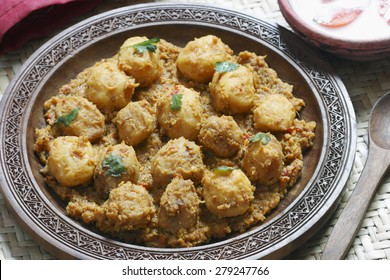 Kashmiri dum aloo made of baby potatoes cooked in yogurt gravy with spices