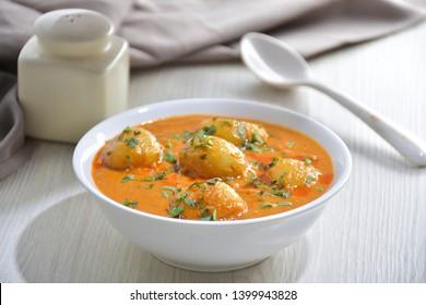 Kashmiri Dum Aloo or spicy Potato Curry, Garnished with Fresh  - Shutterstock ID 1399943828