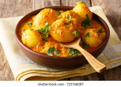 Kashmiri dum aloo: spicy potato with sauce closeup on the plate on the table. Horizontal - Shutterstock ID 725768287