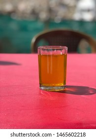 KASHMIRI KAHWA A TRADITIONAL KASHMIRI TEA FLAVOURED WITH CARDAMOM AND INFUSED WITH CLOVES, CINNAMON AND SAFFRON.