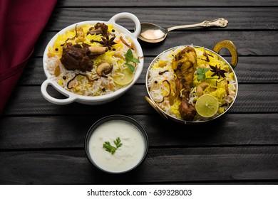 Kashmiri Mutton Gosht or Lamb Biryani prepared in Basmati Rice served with Yogurt dip over moody background, Selective focus
