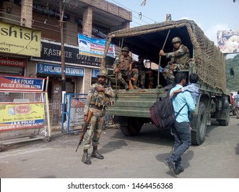 Kashmir/India-Oct 10, 2018: Indian Army soldiers performing their duty in Kashmir in a crowded street.