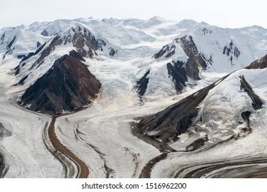 The Kaskawulsh Glacier flows at the base of the mountains in Kluane National Park, Yukon, Canada