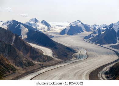 The Kaskawulsh Glacier flows between the mountains in Kluane National Park, Yukon, Canada