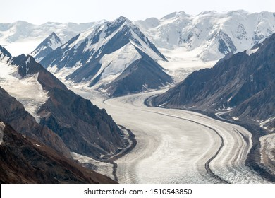 The Kaskawulsh Glacier flows from snowy mountains in Kluane National Park, Yukon, Canada