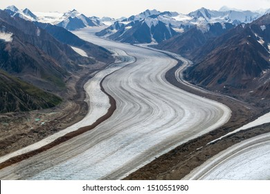 The Kaskawulsh Glacier flows through the mountains in Kluane National Park, Yukon, Canada
