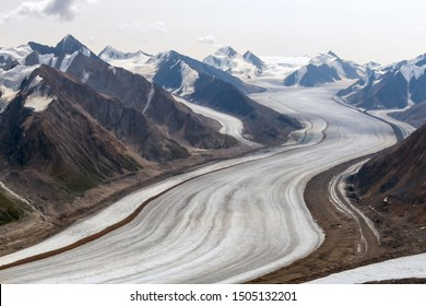 Kaskawulsh Glacier surrounded by mountains in Kluane National Park, Yukon, Canada