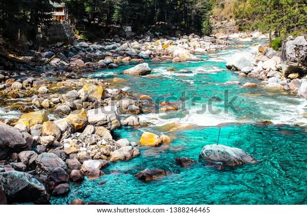 Kasol Manali - Gushing Parvati river in the snow mountains of Himachal Pradesh, India. River water rushing  in the valley of gods. Himachal Pradesh green nature at its best. Himalayas Nature. - Image