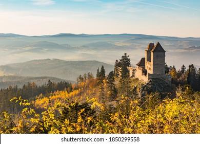 Kasperk Castle in a sunny autumn day. Kasper in the sun's rays. View from the Pusty Hradek viewpoint. South Bohemia, Sumava. Czech Republic - Shutterstock ID 1850299558