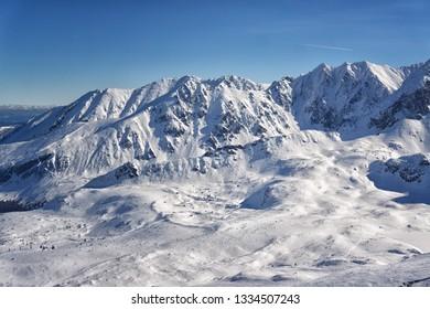 Kasprowy Wierch ski resort with mountains in the background, Zakopane, Poland.