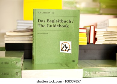 KASSEL � GERMANY - JUNE 23: the guidebook of dOCUMENTA (13) on June 23, 2012 in Kassel. Documenta is one of the most important exhibitions for contemporary art which takes place every five years.
