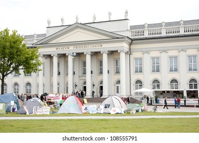 KASSEL, GERMANY -JUNE 23: people visit the Fridericianum on June 23, 2012 in Kassel. This is the main venue of documenta - one of the most important exhibitions for contemporary art.