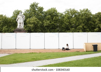 KASSEL -GERMANY - JUNE 23:A woman reads a book in front of the bookstore of dOCUMENTA (13) on June 23, 2012 in Kassel. Documenta is one of the most important exhibitions for contemporary art.