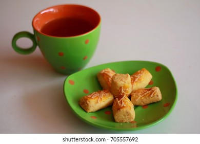 Kastengel or Dutch Indonesian cheese stick cookies and a cup of tea.