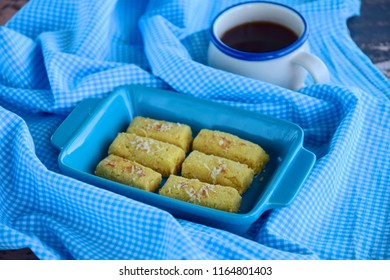 Kastengel or Kue Keju or Dutch Indonesian cheese stick cookies, served with coffee