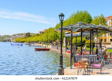 KASTORIA, GREECE - APR 21, 2016: Shore of the Lake Orestiada in Kastoria, West Macedonia, Greece.  The town is known for its many Byzantine churches, Ottoman-era architecture