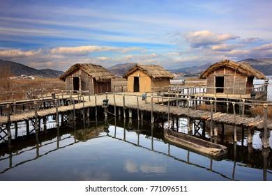"""KASTORIA, GREECE- March 1, 2008. The prehistoric lakeside settlement of Dispilio, in Orestias (or """"Orestiada"""") lake, also known as Kastoria lake, Macedonia."""