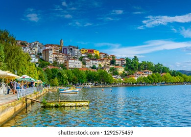 KASTORIA, GREECE, SEPTEMBER 9, 2017: People are walking on waterfront of Kastoria, Greece