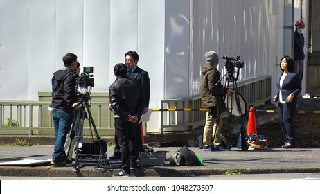 KASUMIGASEKI, TOKYO,  JAPAN - CIRCA MARCH 2018 : NEWS REPORTER and TV CREW shooting in front of MINISTRY OF FINANCE.