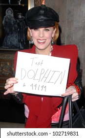 """Kat Kramer holds sign in support of the Japanese dolphin campaign at the """"Cats"""" Touring Company Opening, Pantages Theater, Hollywood, CA. 03-09-10"""