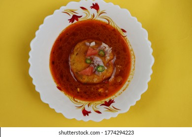 Kat vada, Kat wada or Batata vada sambar or Vada usal, spicy and tasty snack or breakfast,vada or potato patties served in a spicy sauce or curry, particularly in the marathi cuisine, Indian food