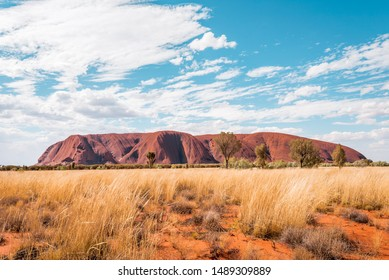 KATA TJUTA NATIONAL PARK, NORTHERN TERRITORY / AUSTRALIA - 13 10 2018: Uluru Ayers Rock Panorama View on a sunny day with a few clouds in the desert of Australias red center and the aboriginal culture