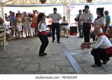 Katakolon, Greece - June 09, 2009: People dancing sirtaki at Katakolon (Greece)