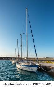 Katakolon, Greece - October 31, 2017: Sail yacht docking at port of Katakolon. Many tourists visiting ruin of Olympia; the birth place of Olympic games.