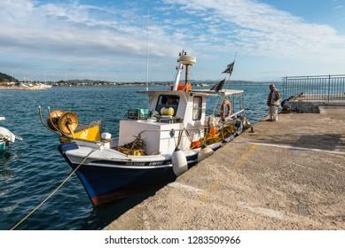 Katakolon, Greece - October 31, 2017: Wooden fishing boats in harbor of the Katakolon (Olimpia), Greece.