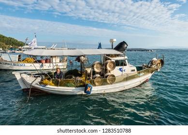 Katakolon, Greece - October 31, 2017: Colorful wooden fishing boats in harbor of the Katakolon (Olimpia), Greece.